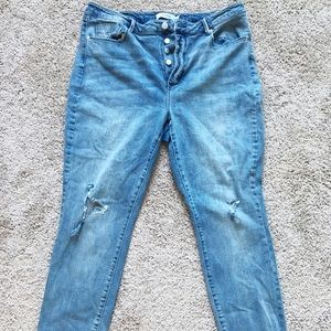 Distressed button fly jeans